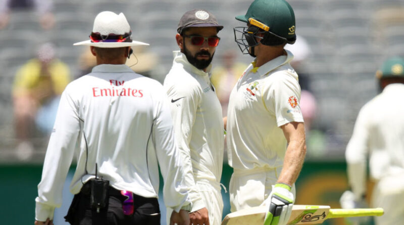 PERTH, AUSTRALIA - DECEMBER 17: Virat Kohli of India and Tim Paine of Australia bump into each other during day four of the second match in the Test series between Australia and India at Perth Stadium on December 17, 2018 in Perth, Australia. (Photo by Cameron Spencer/Getty Images)